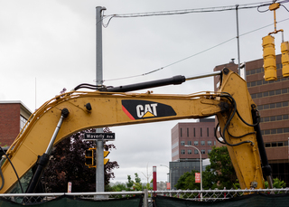 An excavator sits at the edge of the sewer line replacement project along Waverly Avenue near the intersection with University Avenue. The project is expected to be completed in August. Photo taken July 25, 2017